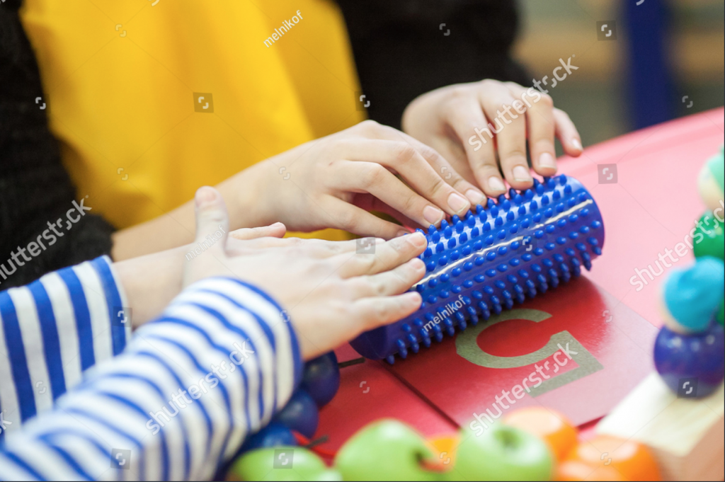 People Holding Toy
