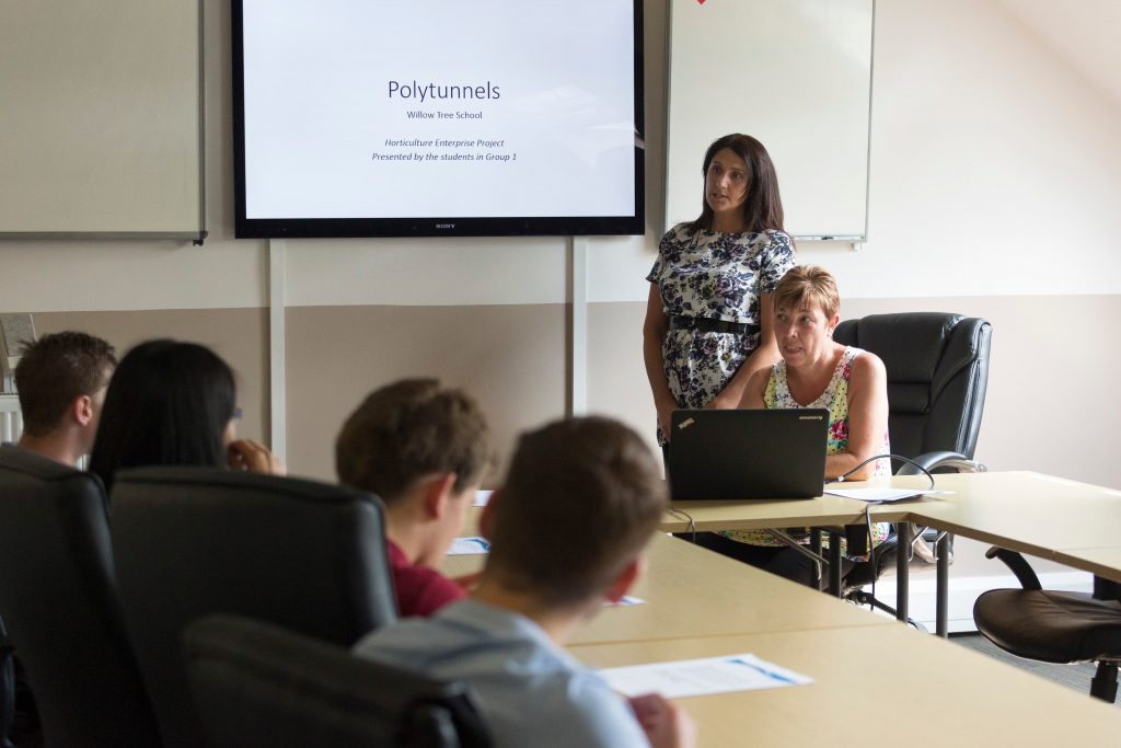 woman presenting to class